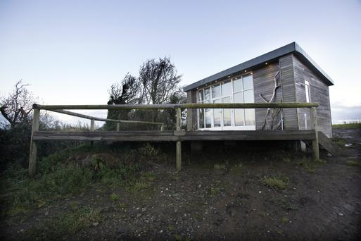 Olga Fitzpatrick's studio, which is clad in cedar, has large expanses of glass, which afford her stunning views of the everchanging sea, just a stone's throw away. Photo: Tony Gavin.
