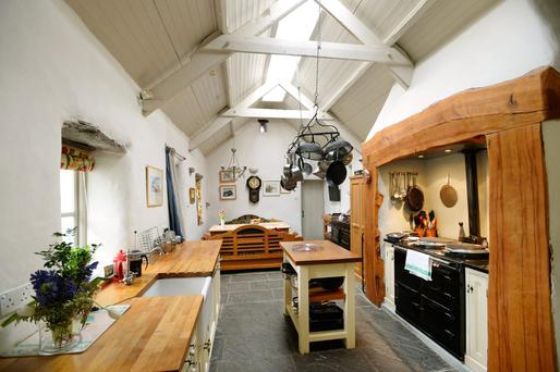 The kitchen was once a pigsty but it has been transformed into a welcoming, living space