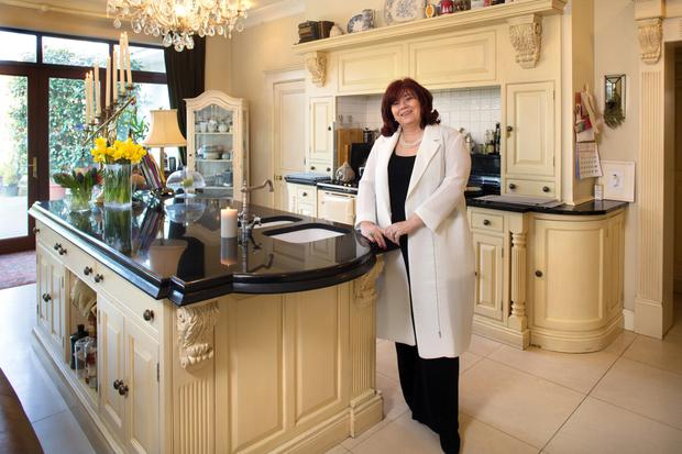 Breda Cashe in her cream and black classic-style kitchen. Both Breda and her husband Cyril are keen cooks and lover their Aga. Photo: Tony Gavin