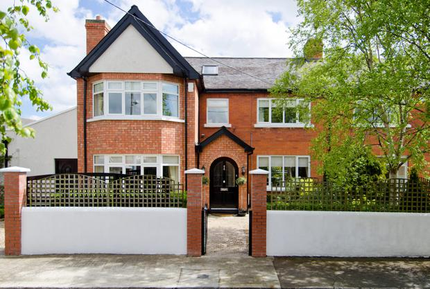 The five-bedroom house is close to parklands and public transport links