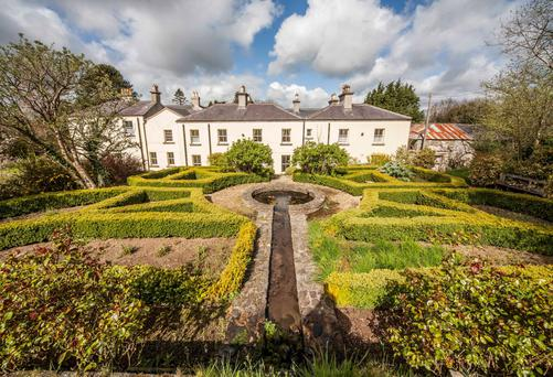 The garden at Clone House is in the Victorian style and is laid out with well-maintained box hedging