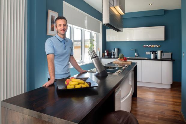 Chef Niall Hill in his kitchen. The teak island is from B&Q, while the appliances are all from the Miele Gallery. Photo: Tony Galvin.