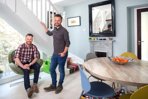 Jamie, left, and Richard in the dining area of their compact house. The table is reclaimed American oak and the chairs are from Arnotts