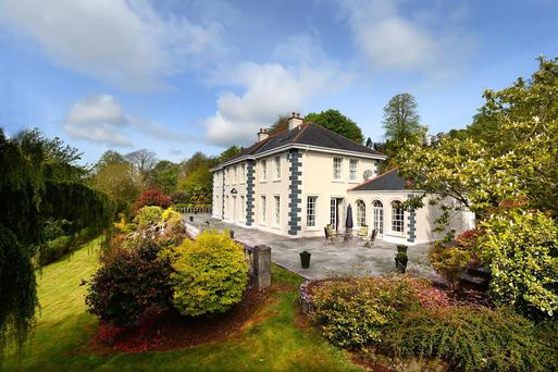 Woodhill House is set on three wooded acres and is laid out symmetrically on two floors