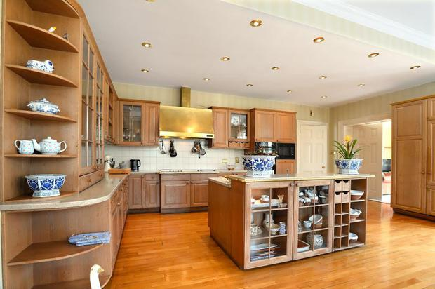 The kitchen has solid oak units and a marble topped island