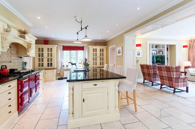 The kitchen is fitted with country-style hand-made units