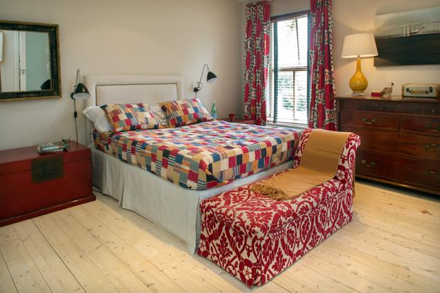 Trisha mixes and matches fabrics in the bedroom. She bought the pair of red lacquer Chinese chests in a fair at the RDS