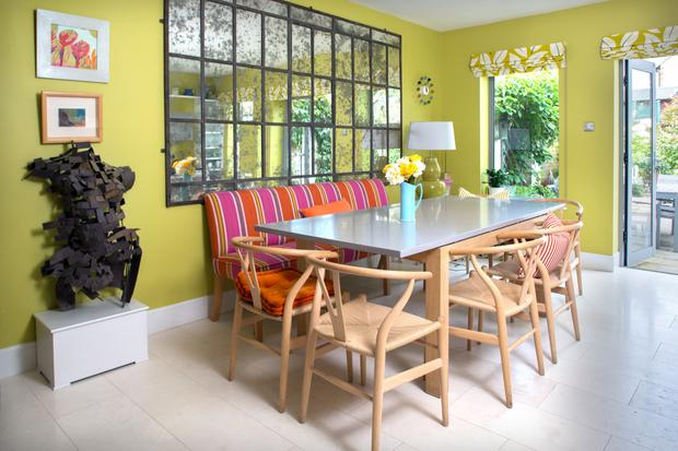 Trisha loves to entertain and she created the table from the legs of an old table and some MDF the length of the striped bench. She got the eglomise mirror with its distressed effect in London
