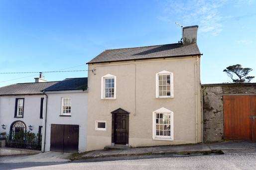 Tots Cottage is a pretty, if not particularly striking, two-storey house fromthe front