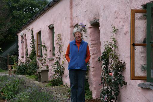 Beth Hallinan outside the cottage she renovated