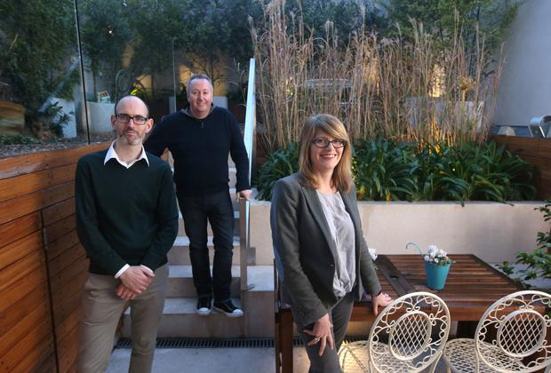 Architect, Diarmaid Brophy, left, with clients, Paula Russell and Michael Roche in the back garden of their home, 188 Harold's Cross Road. Picture credit; Damien Eagers