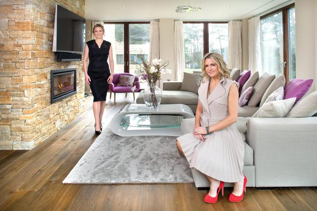 Louise (seated) who is five months pregnant, and her sister, Ciara, who did all the interior design, including the colour scheme in this upstairs living room. Photo: Tony Gavin.