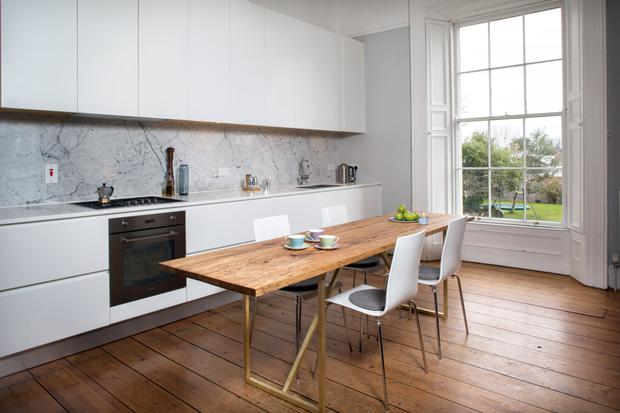 Morwenna used one of the ground-floor reception rooms as a kitchen, creating a light-filled space. The units, designed by Morwenna, were made by Wabi-Sabi, and the kitchen table, made of spalted Irish beech, was created by her brother-in-law, Ed Coveney of Elements of Action.