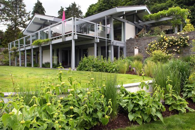 Stan and Ursula Mason's bolthole on the banks of the river Nore is 3,000 square feet and has a wraparound balcon.