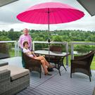 Stan and Ursula Mason on the balcony, with their spectacular views of the river and the rolling parklands beyond.
