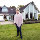 Ann Cafferky, above, outside her architect-designed Delgany home. Photo: Tony Gavin