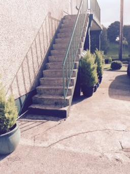 How can we increase the safety and enhance the look of a very 'ugly' outdoor staircase?