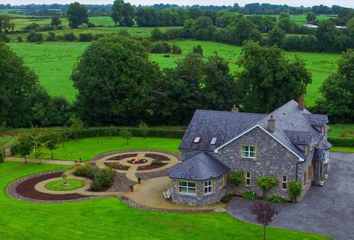 Woolstone House is a finely finished five-bed family home