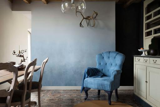 A dining room painted in Dulux Denim Drift, the company's colour of the year