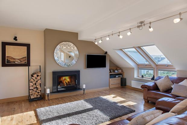 The large living room complete with powerful Bodart & Gonay wood-burning stove
