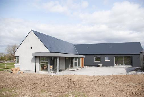 A large extension under construction, above, to side and rear of existing house which required planning permission