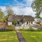 The Thatch, Kilcarty boasts two delightful cottage-style gardens to the front — there is also a patio and large lawn garden at the rear