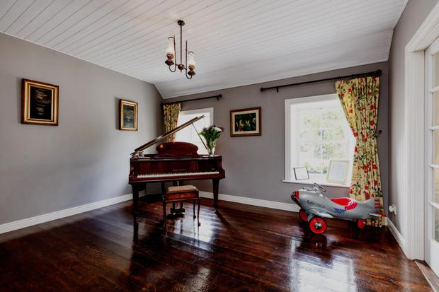 The charming music room with its baby grand that has been in Ronan's family for 110 years
