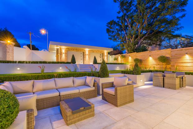 The landscaped garden with outdoor soft seating and night lighting for relaxed entertaining