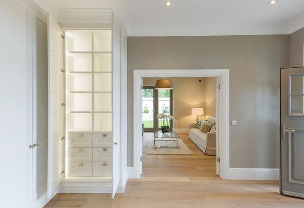 The hallway with bespoke units by Newcastle design, who also did the wardrobes and like the rest of the house comes with underfloor heating