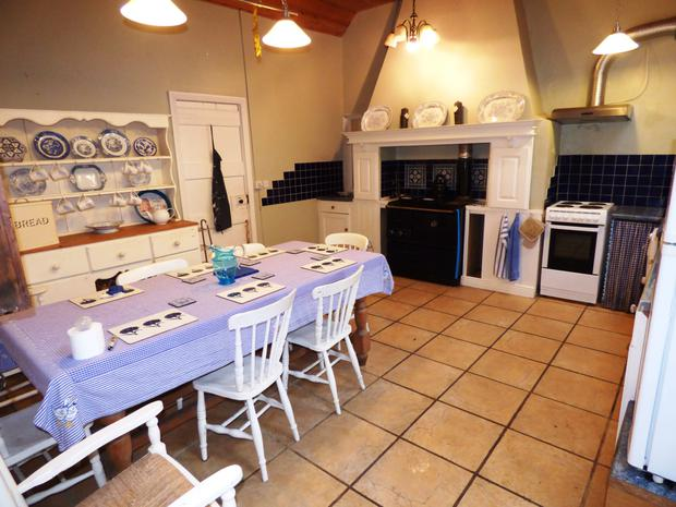 The property has a large, country-style kitchen/ dining room and a Stanley range with Fired Earth tile surround