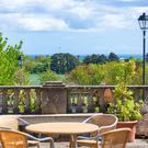 The property offers views of the sea as well as the scheme's gardens
