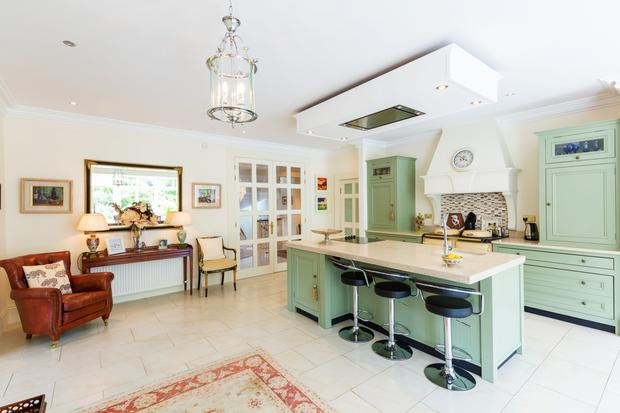The open-plan kitchen has a pantry