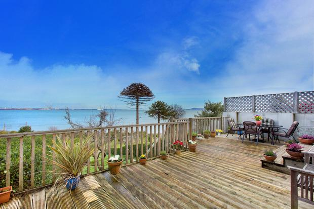All deck on hand: The huge raised deck takes best advantage of the bay views