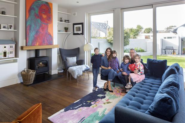 Kerry, her husband Patrick O'Grady, and their four delightful children - Will, Vivienne and twins Harley and James, in their bright living area with sliding door to the back garden.