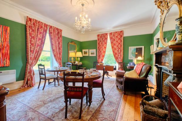 The dining room with mahogany fireplace