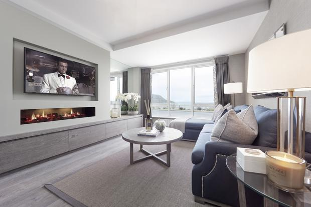 Suave: The centrepiece of the living room at 1 The Shore is an uber-contemporary Opti-V flame-effect electric fire