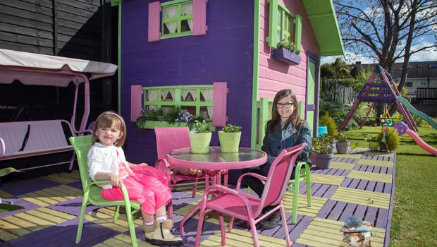 Zuri and Nyah Hill and their playhouse. The garden is also home to an allotment where their dad Niall grows fresh vegetables and herbs for cooking