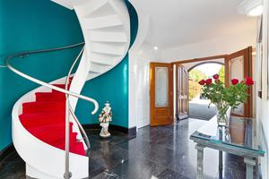 Sakura bespoke spiral staircase with Hollywood-style red carpet