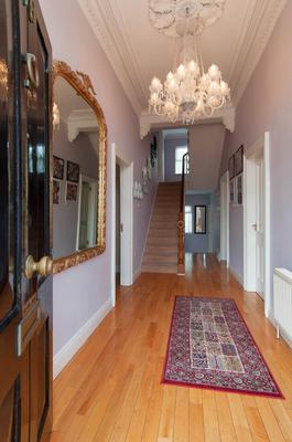 The impressive entrance hall has decorative ceiling plasterwork.