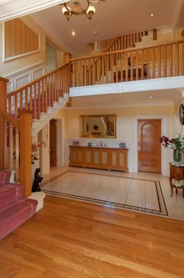 The main entrance hall is double height and comes with a tiled and oak floor.