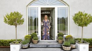 Sarah Battle at the elegantly arched front door of her beautiful home on the edge of Ballina in Co Mayo. The house is a bungalow so the only steps in the house are the two on the way in. It's set on two acres so there's plenty of room for her five young kids to play around