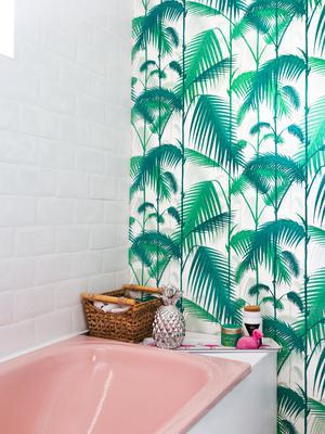 Return of the 70s suite — Cathy sourced the pink suite on Donedeal for €50 and updated the look with tropical print wallpaper by Cole & Son