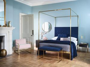 Brass canopy bed at Curated
