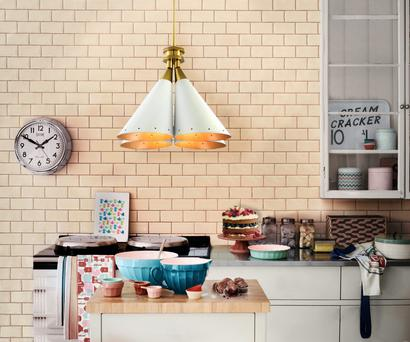 This brass and aluminium Madeleine suspension light shines over a retro kitchen set with candy colours. €1,260 plus VAT, williedugganlighting.com.