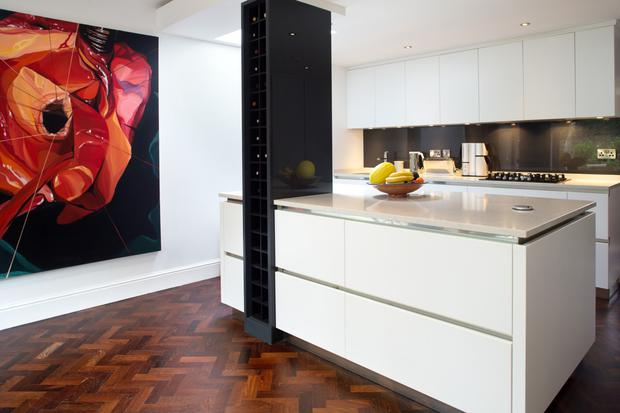 The streamlined kitchen - a Linea Quattro kitchen - was installed by Peter Bernard. The wine rack is also a supporting beam.