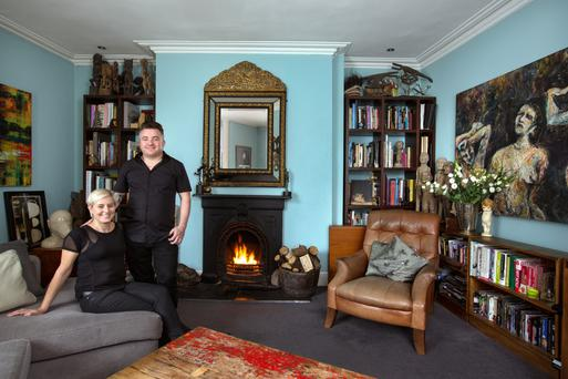 Darren and his wife Lorraine in the living room of their home in Dublin 8. Photo: Tony Gavin