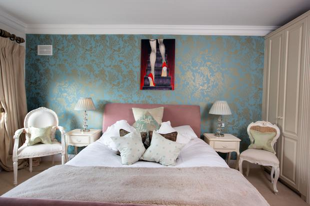 A painting by Nina Divito hangs over Vivienne's bed. She wanted her bedroom to be