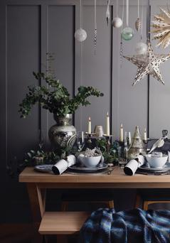 Tea lights and greenery can dress up your festive table. Photo: Marks and Spencer.