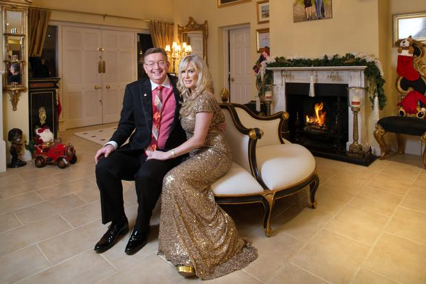 Gerald Kean and Lisa Murphy at home by the fire in the reception room of Drayton Manor, Co. Wicklow.