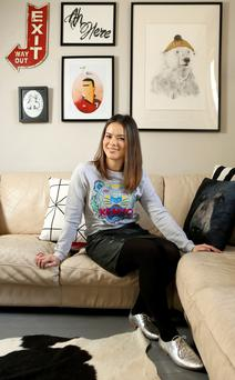 Siobhan Lam in her living room, which leads open plan into the dining area.